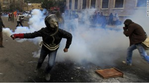Rioters in Egypt throw back teargas.