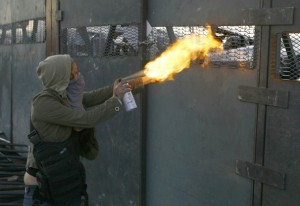 A protestor in Mexico attacks riot police with a homemade blowtorch