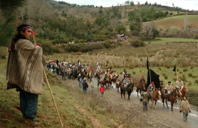 Members of the Mapuches Indians Movement ride their horses during the burial ceremony of Collio near Temuco city